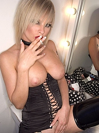Smoking bitch in black lingerie has big boobs and cute face pictures at freekilomovies.com