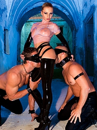 Fetish horny babe in latex double penetrated by these guys pictures