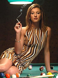 Beautiful sexy smoking girl posing on the pool table for us pictures at kilogirls.com