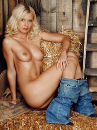 Hot blonde goes dildo crazy in the barn pictures at freekilosex.com
