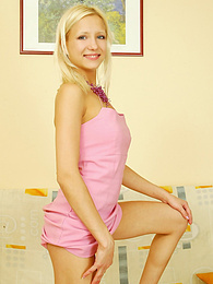 Stunning blonde in her purple top and panties pictures at kilogirls.com