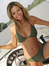 Cute blonde gets horny on a boat pictures