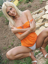 Sexy young blonde masturbates outdoors pictures