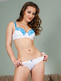 Dani Daniels pulls down her panties to reveal her lovely landing strip pictures