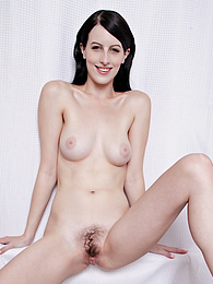 Perky breasted Alex Harper spreads her hairy pussy pictures at freekilosex.com