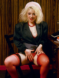 Blonde sexy secretary Ann is getting horny wet in the office pictures