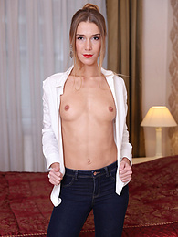 Alexis Crystal in a white blouse and tight jeans pictures