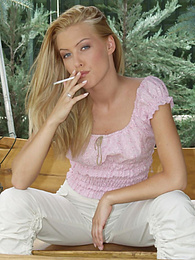 Stunning blonde poses on the table outside pictures at kilogirls.com