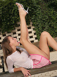Showing off her perfect body in the garden pictures at freekilosex.com