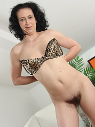 Hairy mature babe Rosetta rides her glass toy pictures at freekilosex.com