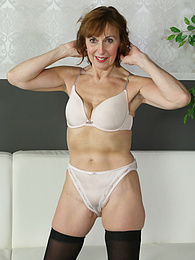 Mature redhead Amy D posing naked in only her black stockings pictures at kilogirls.com