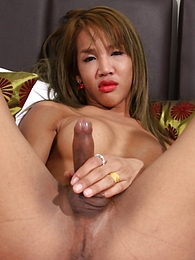 Lyla In A Kinky Red Outfit Strips And Plays With Her Cock pictures at freekiloporn.com