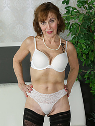 Older mature amateur Amy D naked in only black stockings pictures at freekiloporn.com