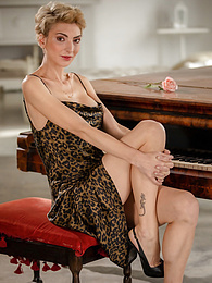 Super fit blonde MILF Natalie Anna sits naked at her piano pictures