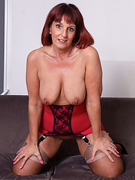 Thick mature babe Beau Diamonds toys her beautiful twat pictures at find-best-panties.com