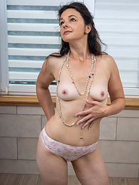 Sexy brunette MILF Anette Harper masturbates in the bathroom pictures at find-best-panties.com