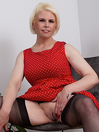 Mature babe Skyler Squirt spreads her stocking covered legs and fingers her clit pictures at freekiloporn.com