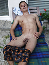 Jody busts a nut all over his chest in the backyard pictures at freekiloclips.com