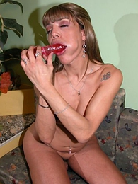 Blonde shemale from Argentina Ingrid playing with dildo insertions in her open ass pictures