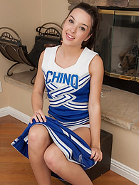 Cheerleader Jaslene Jade spreads her shaved pussy lips pictures at kilopics.net