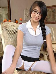 Brown eyed cutie Megan Salinas naked in white stockings pictures at freekilomovies.com