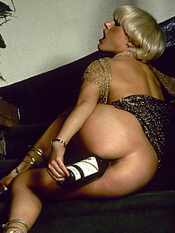Beautiful blonde chick rubbing herself against a wine bottle pictures at kilovideos.com