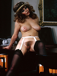 Brunette retro chick showing of her big beautiful naturals pictures at freekiloclips.com