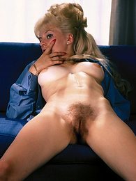 Hairy blonde with a big pile of hair showing her furry slit pictures at find-best-panties.com