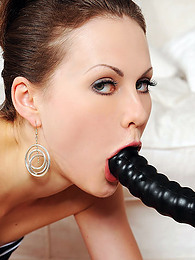 Adorable and awesome minx with astonishing tits is banging her love tunnel with dildo pictures