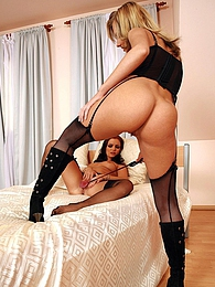Frisky and nude blonde in black stockings is playing with her attractive colleague pictures at kilomatures.com