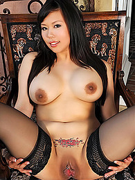 Busty asian doll with piercing on her shaved love tunnel is showing her appetizing backdoor indoors pictures