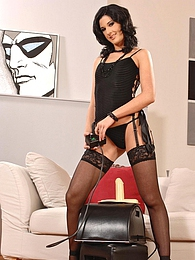 Elegant babe Lulu Martinez in black lingerie and fancy stockings drills her lascivious slit with a vibrator pictures