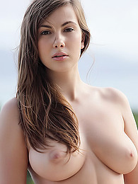 Connie Carter bares her big natural breasts on the deck as the wind blows pictures at find-best-ass.com