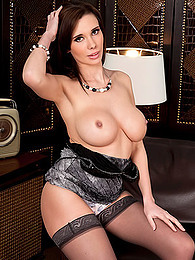 Sabrina Perri has gorgeous implants and brings them out for her picture set pictures at freekilosex.com