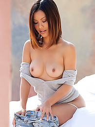 Asian strips from her gray sweater to show us her sexy tits with hard nips pictures