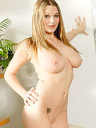 Skintight top against the huge natural titties of model Cassandra Calogera pictures at freekilomovies.com