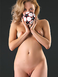 Soccer fan in jersey, socks, and scarf has fun taking her clothes off pictures at find-best-videos.com