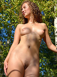 Leggy nude girl goes on a walk in the woods and she is perfection pictures