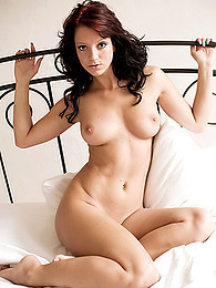 Join the young lady in bed for beautiful posing pictures on the sheets pictures