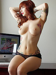Watch her strip from a sexy outfit and show off her many sexy tattoos pictures at freekiloclips.com
