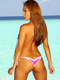 Crystal clear ocean water stretches out behind Kt So in sexy pics pictures at find-best-ass.com