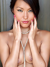 This Asian babe is pretty and she poses naked with only a pearl necklace pictures at find-best-ass.com