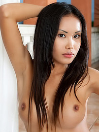 Asian with plump lips shows her hot ass and her small titties pictures
