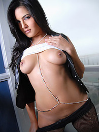 Pretty girl Sunny Leone wears pantyhose and shows off her pierced nipples pictures at find-best-mature.com