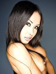 Asian girl is glamorous and shows her tongue piercing and perky tits pictures