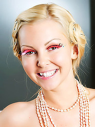 She smiles brightly while wearing her vintage outfit and makeup pictures at kilovideos.com