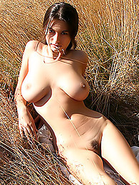 Amazingly pretty young lady naked on the field pictures