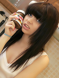 Teeny smokes a cig, takes clothes off and smears herself with Nutella pictures at freekilosex.com