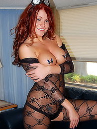 Redheaded hottie in a body stocking is showing us plenty and arousing pictures at find-best-babes.com