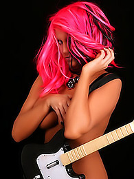 Ember Reigns with pink hair shows off her magnificent and tasty curves pictures at dailyadult.info
